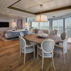 Beach style condo boasts magnificent views of the Gulf of Mexico Dinning Chairs, Round Dining Table, Kitchen Sitting Areas, Classic House Design, Beach House Decor, Home Decor, Beach Condo, Beach Houses, Home Ceiling