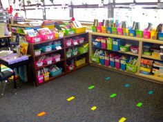 Did you notice the duct tape on my carpet? I use it to assign seats during circle time. I have five colors in rainbow order (pink, orange, yellow, green, and teal). It coordinates perfectly with my brightly colored baskets and helps so much with classroom management during circle time.