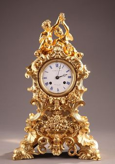 A French 19th century ormolu clock in rococo style ornate with-bacchanal / Le Roy et Fils, H. Rs du Roi à Paris.  Circa: 1870 / http://www.artquid.com/artwork/136479/a-french-19th-century-ormolu-clock-in-rococo-style-ornate-with-bacchanal.html