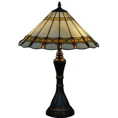 @Overstock.com.com.com - This classy 'Jeweled' Tiffany style table lamp is an elegant piece made with more than 150 hand-cut pieces of glass plus 30 'jewels' and soldered into a beautiful shade. This piece is handcrafted using  techniques developed by Louis Comfort Tiffany.http://www.overstock.com/Home-Garden/Jeweled-Handcrafted-Stained-Glass-Tiffany-Style-Table-Lamp/7315909/product.html?CID=214117 $117.99
