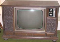 60s Console Color TV - No flat screens back then...at one point we had one with a remote control with a 20 foot cord that plugged into the front...