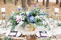 Blooming centerpiece with purple and gold table settings - photo by Jen & Chris Creed