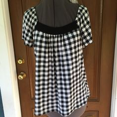 "CHRISTINE GERARD B&W Checked Top CHRISTINE GERARD B&W Checked Top.  Short sleeves.  Black & white checked stretchy polyester/spandex material.  Length 24-1/2"" (shoulder to hem). NGreat condition. Christine Gerard Tops Blouses"