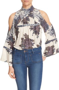 Intricately embroidered paisleys frame the cold-shoulder cutouts and crisscrossed neckline of this voluminous top from Free People.