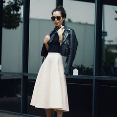 Nail an edgy-meets-prim 50s vibe with a full midi skirt, neckerchief, and leather moto jacket.