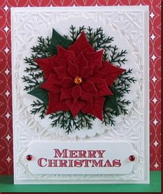 The poinsettia is made with a Spellbinders die.