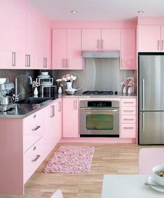 Pink kitchen. I wish my husband would even consider this. With a black and white checker board floor. Old school black and stainless Formica dining set and bar stools. Gold Kitchen, Kitchen Shop, Kitchen Tables For Sale, Kitchen Hutch, Kitchen Cabinet Colors, Kitchen Cabinet Remodel, Kitchen Colors, Home Decor Kitchen, Kitchen Design