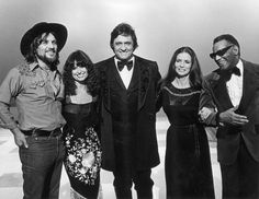 Johnny Cash invites friends Waylon Jennings (left), Jessi Colter, wife June Carter and Ray Charles to pose for a promotional portrait for his television special Johnny Cash: Spring Fever on April 14, 1978.