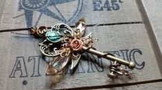 Wire wrapped skeleton key with fairy wings!  https://www.etsy.com/shop/LepidusPlasmatio https://www.facebook.com/LepidusPlasmatio