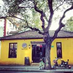 Little yellow cafe store at Taojiang road
