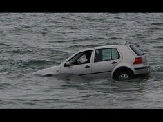 Pensioner rescued after driving her VW Golf into the sea