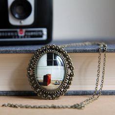 Cute photo pendant necklace. All original photographs. Pretty cool!