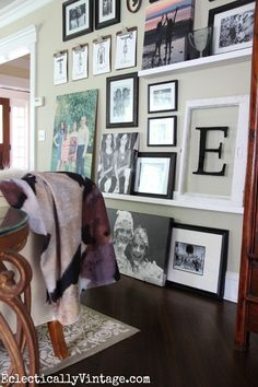 Make an eclectic interchangeable gallery wall using ledges, clipboards and black frames from Homegoods! eclecticallyvintage.com #homegoodshappy #happybydesign #sponsored