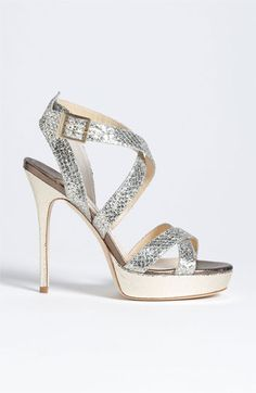 "Jimmy Choo 'Vamp'  Sandal - Crisscrossing straps of glitter-infused fabric encase the foot in a chic, breezy platform sandal. Adjustable strap with buckle closure. Approx. heel height: 4 1/2"" with a 1"" platform (comparable to a 3 1/2"" heel). Fabric and leather upper/leather lining and sole. Made in Italy. Salon Shoes."
