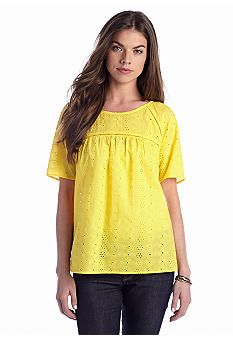 Yellow is the color this spring! Find this on-trend top at Belk.