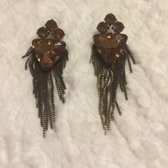 Brown dangly statement earrings These are great for a fancy night out. Dangly statement earrings with some brown jeweled accents. Only worn once and they've been sanitized. Charming Charlie Jewelry Earrings