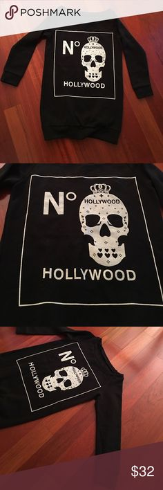 Sweatshirt skull 💀 and Hollywood graphic design Sweatshirt skull 💀 and Hollywood graphic design. Very cute size is small but fits best extra small to small sizes. Color black and white. Condition excellent EUC. Only worn a couple of times. Offers welcome and all purchases receive free gift 🎁! boutique Tops Sweatshirts & Hoodies