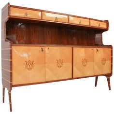 Stunning Italian Mid-Century Modern Sideboard, 1960s   From a unique collection of antique and modern sideboards at https://www.1stdibs.com/furniture/storage-case-pieces/sideboards/