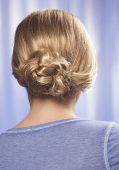 Beautiful fishtail bun for rehearsal dinner hair style. Save money on hiring a professional twice and create this elegant, easy style at home. http://www.hairperfecter.com/how-to-do-a-fishtail-braid/