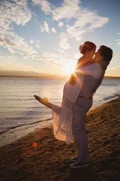 On the beach and in the sun - bride and groom
