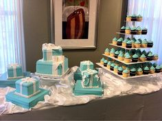 love the idea of a traditional cake and then a cupcake tower..guest can just grab and eat