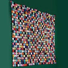Large 76-inch-by-88-inch hand-sewn Yo-Yo quilt made from polyester-cotton blend and contains 891 yo-yos.