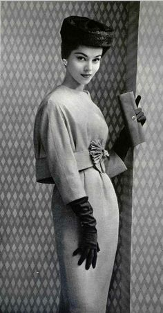 1957 Model in elegant beige wool dress with short bolero decorated with large rosette by Lanvin-Castillo,