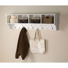 Stop losing your keys and get organized with this hanging entryway shelf. The durable fresh white laminate-finished shelf is easy to install. You can hang keys, coats, handbags, backpacks and more, and you can be creative with the storage compartments.