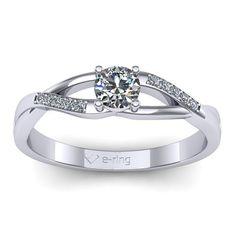 Inelul este realizat din aur alb 14k, greutate: ~2.50gr. Produsul are in componenta sa: 1 x diamant, dimensiune: ~3.70mm, greutate: 0.20ct , culoare: G, claritate: VS2, forma: round 10 x diamant, dimensiune: ~1.00mm, greutate totala: ~0.05ct, culoare: G, claritate: SI1, forma: round