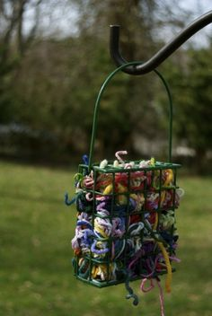 Use a suet feeder to hold scraps of yarn for birds to use in their nests. Great spring project! - Continued!