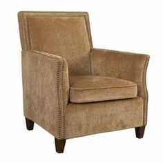 """Arm chair with tan upholstery and nailhead trim.   Product: ChairConstruction Material: Wood frame and fabric seatColor: ChestnutFeatures:  Plush flaxen and softly sculpted reptile fabric upholsteryDouble row nailhead trimClean profile and neautral hue Dimensions: 37"""" H x 30"""" W x 32"""" D"""