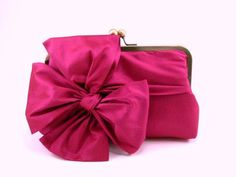 The queen of the bows, one might say. The fuchsia bow clutch has been one of the most popular clutch.http:ecovolenow.com