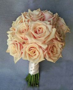 """One of my favorite peach roses """"Talia"""" opens just beautifully.  Bridal bouquet by Dahlia Floral Design"""