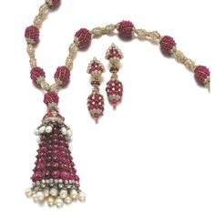 IMPORTANT GEM SET AND DIAMOND DEMI-PARURE Comprising: a necklace composed of clusters of ruby beads, highlighted with cushion-shaped, circular-, single-cut and rose diamonds, suspending a tassel capped with cushion-shaped and circular-cut rubies, embellished with drop-shaped and round natural pearls, interior length approximately 570mm; and a pair of ear clips.
