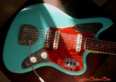 A Foam Green Fender Jaguar relic body by Revelator Guitars