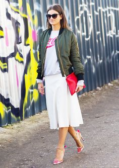 White midi-skirt with a army green bomber jacket