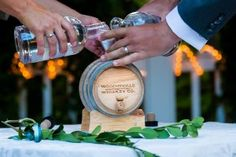 Instead of a sand ceremony or unity candle, this Tapestry House couple had a whiskey ceremony in which they poured little bottles of whiskey in a mini-keg! How cool is that?? Photo by Tom K. Photography