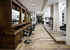 Mc Elhinney's Salon | Love black and brown together. Recreate this look with The Woodrow All Purpose Chair http://stand.sh/woodrow paired with The London Big Ben Styling Station http://stand.sh/bigben #salon #salondecor #hairsalon #salonequipment #barber #barbershop #inspiration #design