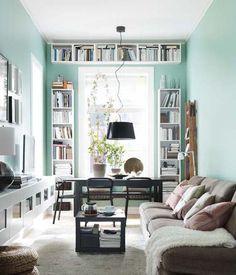 mint green walls. pink cushions.