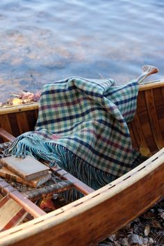 """Autumn is the perfect season to set adrift on the lake and immerse yourself in a good book. Stave off the chill by snuggling into this """"Tay"""" reversible lamb's-wool throw from Johnstons of Elgin."""