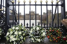 Wreaths of white roses were placed in front of Blenheim Palace's wrought iron and gold gate at the death of the 11th Duke of Marlborough.