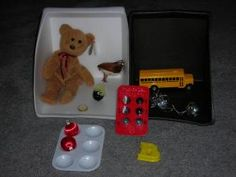 Alpha Boxes with #tactile interest and familiar objects teach letter and sound recognition.  Think of these as ABC readers for your child who is #blind or visually impaired.