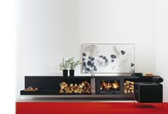 Fire is life. Make sure to harmoniously integrate this comfortable heat in your environment by means of the modular balance chimney stove.   The well thought-out system serves to combine the constructional unit of the chimney stove with the handcrafted pieces of furniture such as chest of drawers, shelves and bench seats with leather cushion or storage compartment elements for firewood and adapts perfectly to any room design due to its harmoniously shaped lines.
