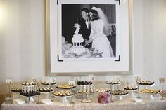 The photo above the dessert table is of the bride's parents cutting the cake at their wedding. Such a personal touch!