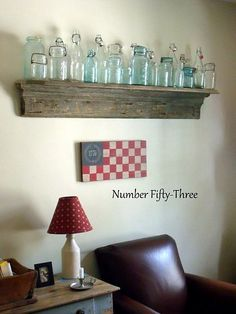 I have so many of these blue mason jars displayed on top of my cabinets, I like this better so it looks like another project in the works.