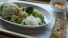 Bibimbab with brown bread, tofu topping, vegetables and sesame sauce.
