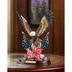 "The magnificent wings of the valiant Bald Eagle spread gloriously over the unfurled stars-and-stripes. Dimensions 7"" x 4.25"" x 9.38"""