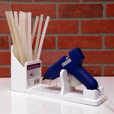 Our Hot Glue Gun Stand is the perfect accessory for your craft room. Avoid a drippy hot glue mess by using our Hot Glue Gun Stand. Glue Gun Holder, Glue Gun Crafts, Cool Guns, Diy Home Crafts, Craft Storage, Woodworking Projects, Hot Glue Guns, Gadgets, Crafting