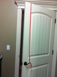 I don't have to baby proof anymore, but for those of you that do, I think this is genius (if you have lever doorknobs).  Staple a length of ribbon to the top of a door and tie it to the knob.  Door will only open if you push up on knob, so little ones can't pull down and get the door open.  :)