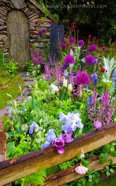 stone potting shed, split rail fence, mixed flower frenzy